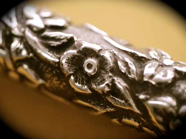 A close-up of the repoussé work
